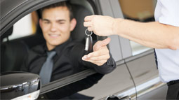 handing car keys to a driver